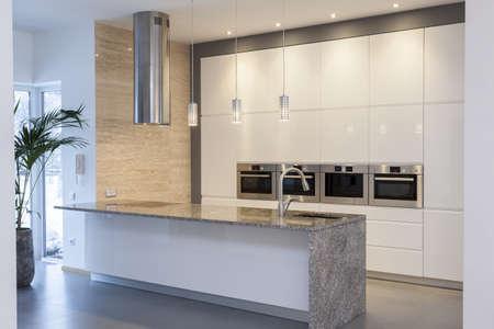 countertop: Designers interior - Kitchen in a mininalist house interior Stock Photo