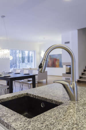 stone fireplace: Designers interior - Closeup of tap and faucet