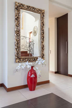 classy house: Classy house - decorative mirror and a flower