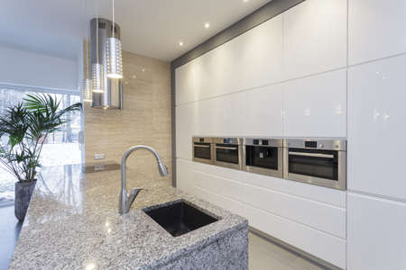 travertine house: Designers interior - interior of modern minimalist kitchen