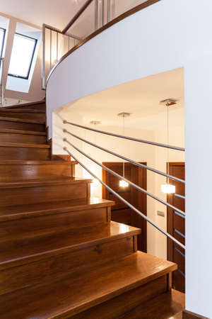 Grand design - Closeup of wooden elegant staircase photo