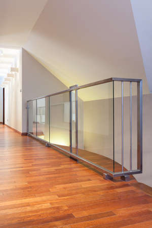 Grand design - closeup of glass banister at second floor photo