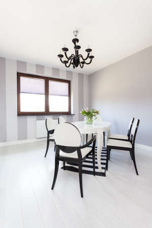 dining room interior: Vibrant cottage - Modern table with black and white chairs
