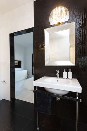 Vibrant cottage - White sink in black bathroom photo