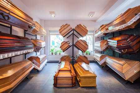 cremation: Funeral home with plenty of different coffins Stock Photo