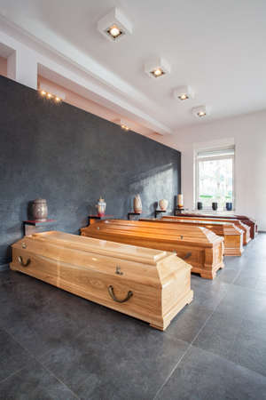 cremation: Coffins and urns in a funeral house