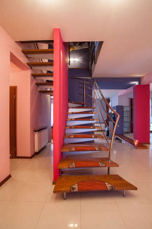 Amaranth house - Stairs with pink wall and metal banister Stock Photo - 18725980