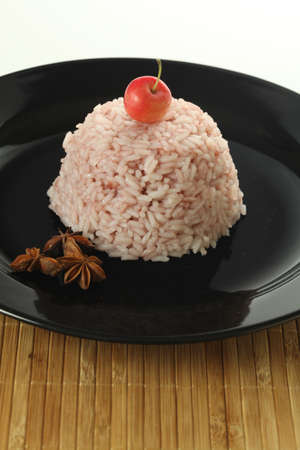A rice dessert served with anise and cherry Stock Photo - 18868561