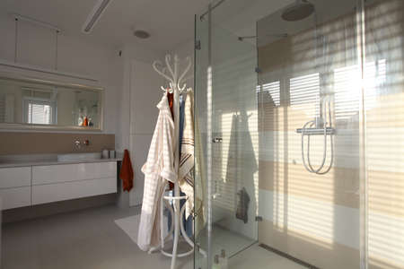 Shower with glass walls with bright elegant bathroom photo