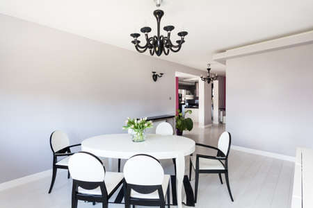 Vibrant cottage - white and black dining room photo