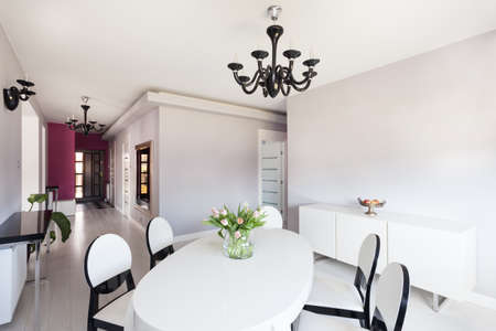 Vibrant cottage - bright inter with white table and chairs Stock Photo - 18815714