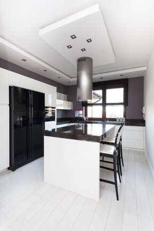 Vibrant cottage - interior of modern black and white kitchen photo