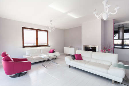 Vibrant cottage - modern living room with pink armchair photo