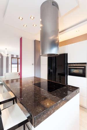 Vibrant cottage - stone countertop and kitchen furniture photo
