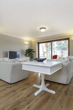 Tuscany - white furniture in beige living room photo