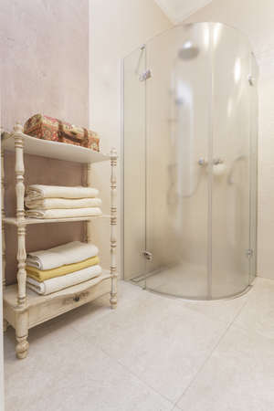 Tuscany - glass shower in bright bathroom photo