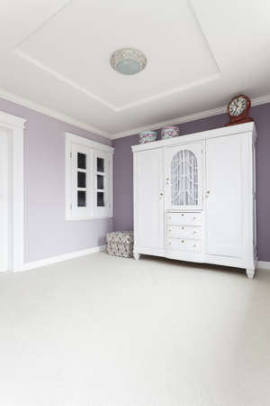 Tuscany - white wardrobe in bright purple bedroom photo
