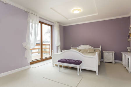 mediterranean interior: Tuscany - interior of purple bedroom with white furniture