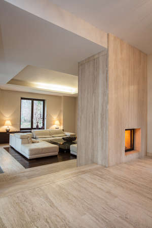 stone fireplace: Travertine house: Modern contemporary hallway