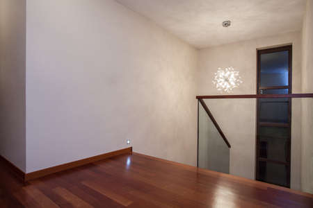 Travertine house- Horizontal view of wooden floor and bright walls photo