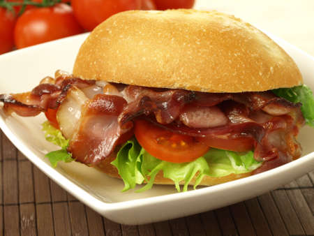 Bid sandwich with bacon and vegetables photo