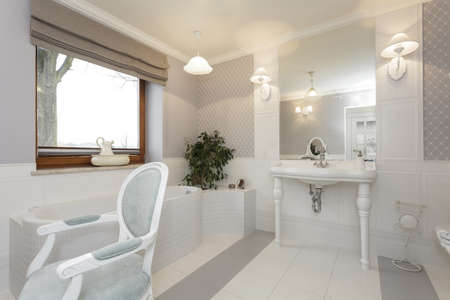 Tuscany - White bathroom with classic chair Stock Photo - 18915887