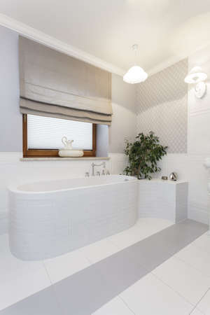 Tuscany - stylish white bath in bathroom photo