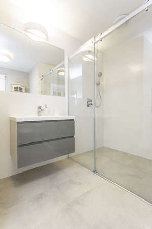 Tuscany - grey furniture in white bathroom photo