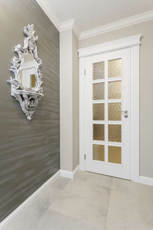 mediterranean interior: Tuscany - white door in grey room