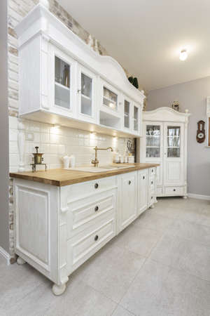Tuscany - white shelves in classic kitchen photo