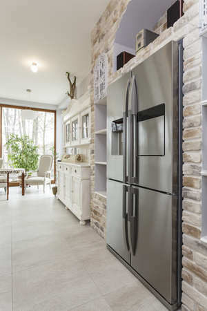 Tuscany - silver refrigerator in kitchen interior photo