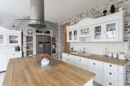 Tuscany - white kitchen shelves and silver refrigerator photo