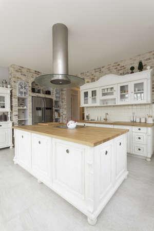 kitchen appliances: Tuscany - white kitchen countertop with cooker Stock Photo