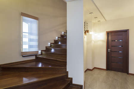 Grand design - Staircase with wooden steps and metal banister Stock Photo - 19058420