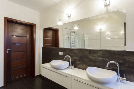 Grand design - two wash basins in contemporary bathroom photo