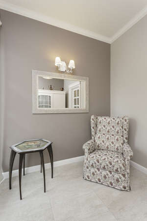 Tuscany - floral armchair in corner of room