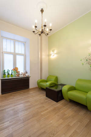 Modern waiting room with a wooden floor Stock Photo - 19265076