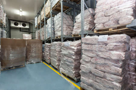 food distribution: Warehouse with a portion of frozen meat, cold store Stock Photo