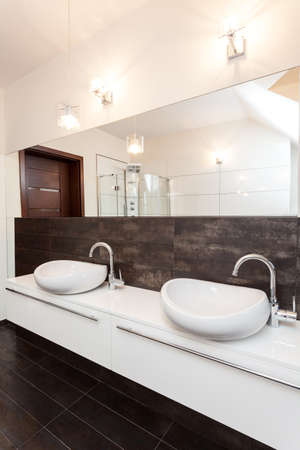 Grand design - two vessel sink in bathroom photo