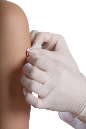 Hands in gloves putting a blister on arm Stock Photo - 19457627