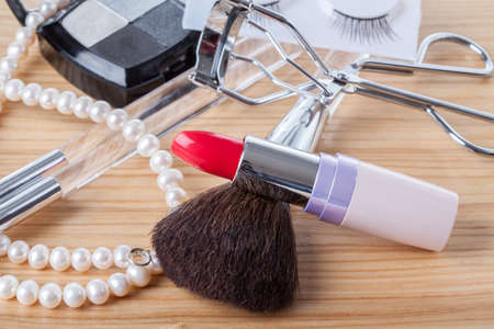 Red lipstick, eye shadows and pearls, woman stuff Stock Photo - 19457652