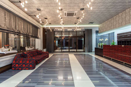 Woodland hotel - main entrance, luxurious hall and couch