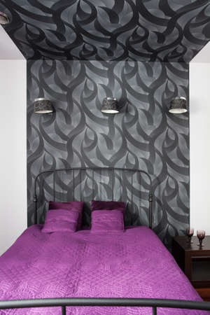 Country home - modern bed in patterned bedroom interior photo