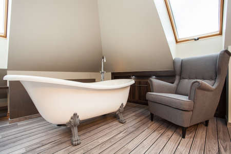 Country home - bath and cosy armchair in bathroom Stock Photo - 19421624