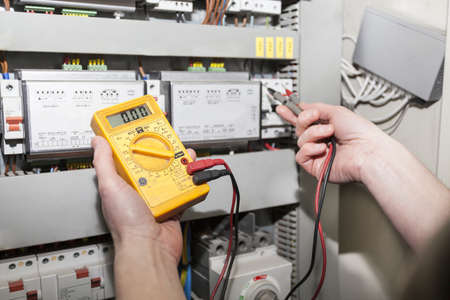 Multimeter - checking a switchboard, close up Banco de Imagens
