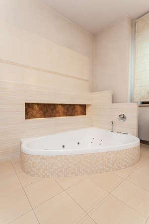 classy house: Classy house - bright bathtub in modern bathroom Stock Photo