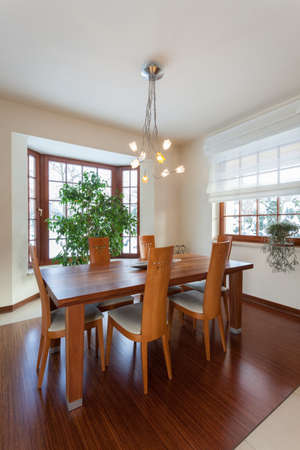 Classy house - dining room with brown wooden table Stock Photo - 19483018