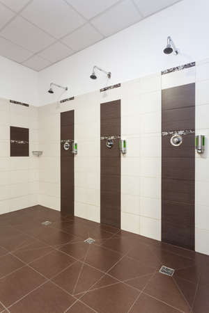 showers: Three showers in a modern bathroom interior