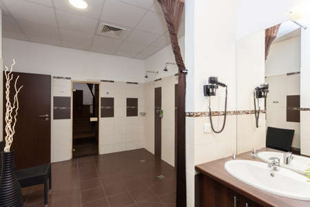 Public bathroom with a showers and sauna photo