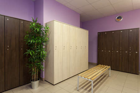 changing clothes: Interior of a new modern locker room Stock Photo